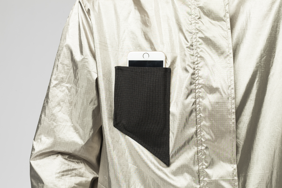 Black pocket with phone